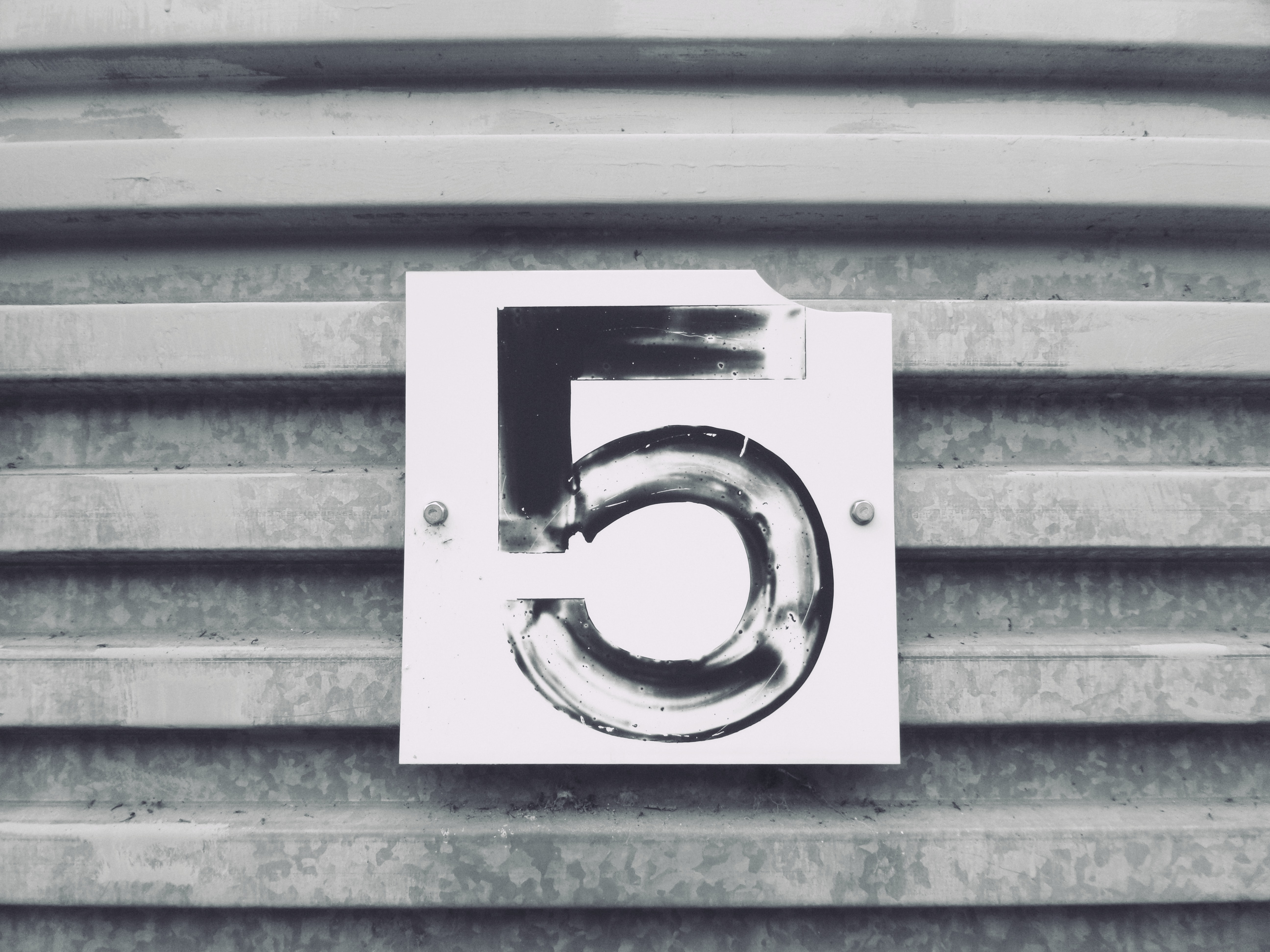 The number 5 on a sign
