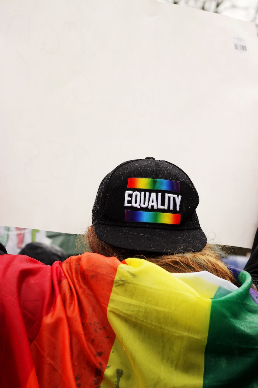 Hat with equality written on the back with a rainbow banner