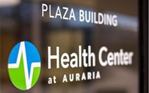 The entrance door of the Auraria Campus Health Center with the logo Plaza Building Health Center at Auraria