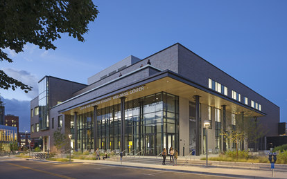 An evening photo of the Lola and Rob Salazar Student Wellness Center