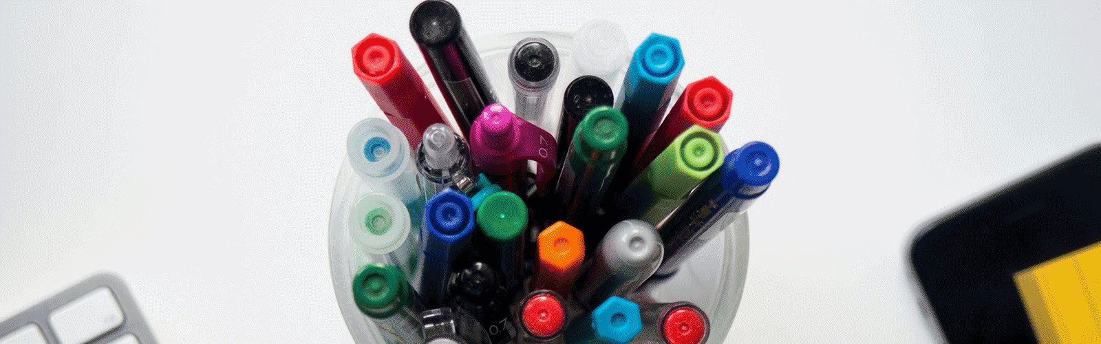 An image of a cup full of markers