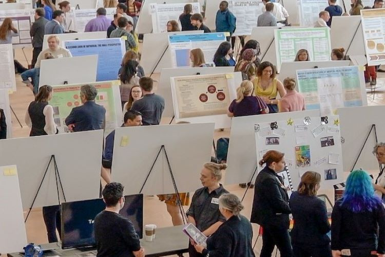 Students presenting research projects at a symposium