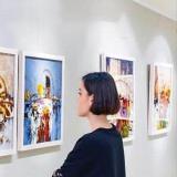 Woman looking at paintings