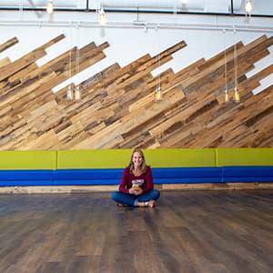 Karen Hertz sitting in the new empty taproom
