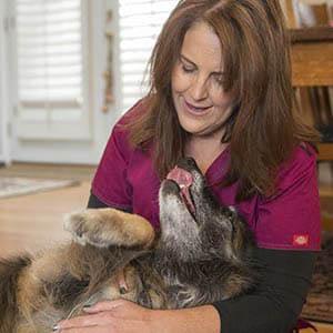 Lisa Nickens snuggling a dog