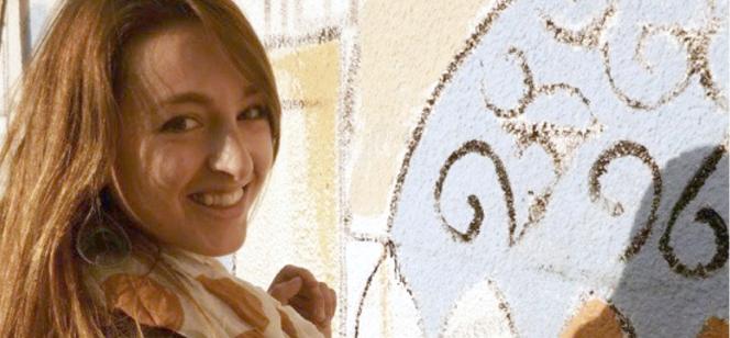 Marissa Bennett painting on a wall