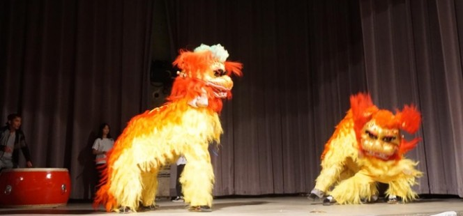 actors in lion costumes on stage