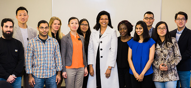 Dr. Kim Hunter Reed with international students