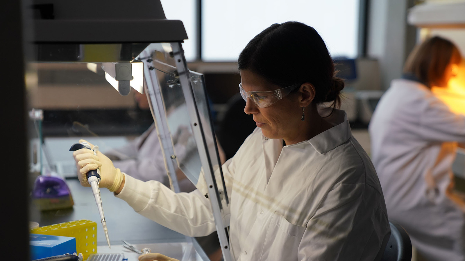 Researcher working in a lab with pipette