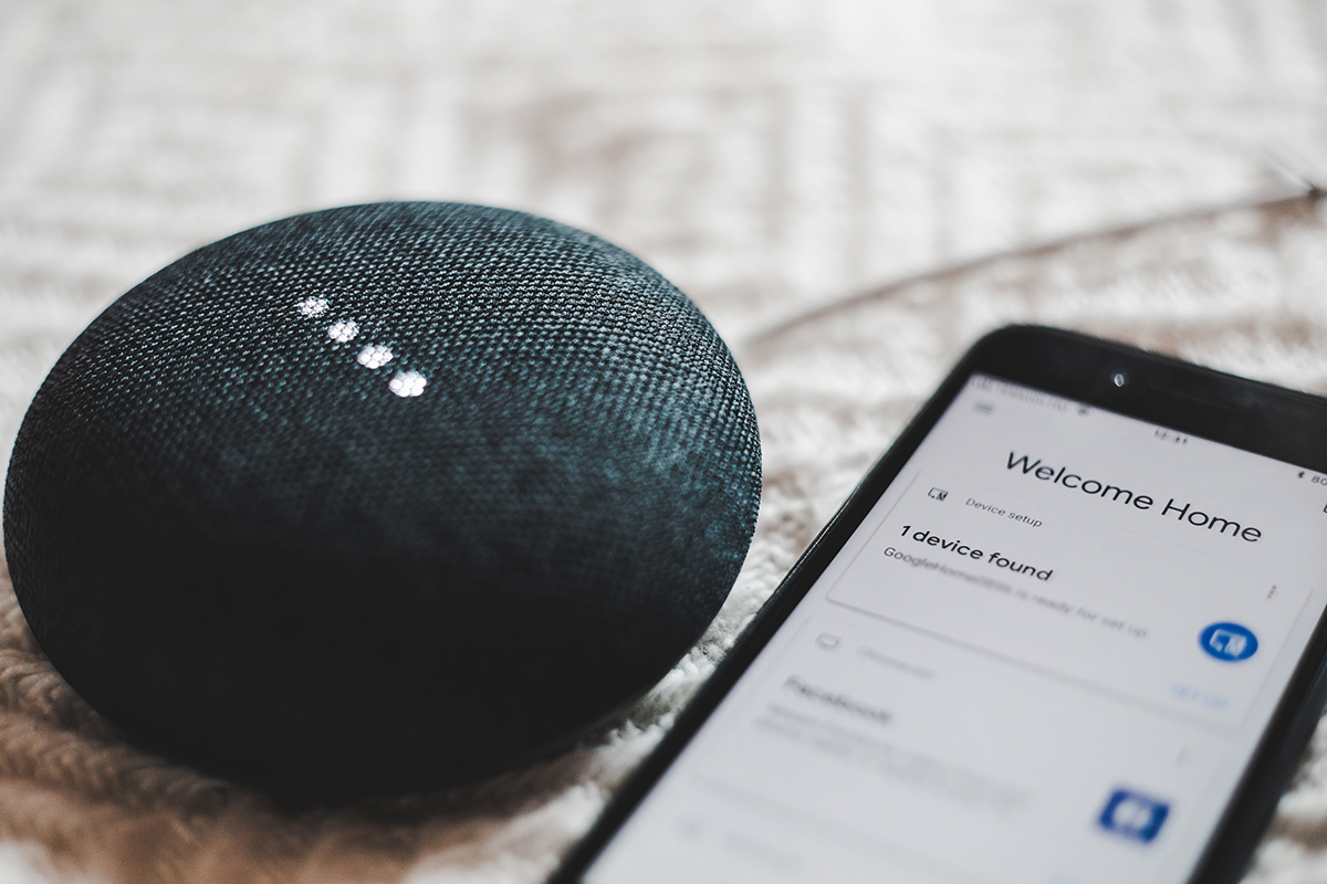 Image of smart phone and smart home device by Bence Boros on Unsplash